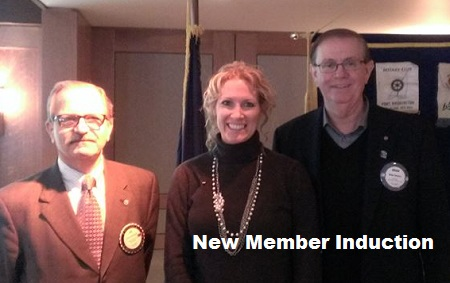 New member being inducted into East Lansing Rotary