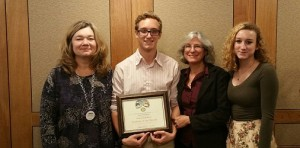 Daniel Hoffman pictured with his Students of the Month Award