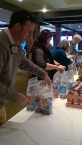 Rotarians and guests packing WSK at the Friend Raiser